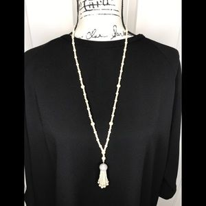 White pearl tassel necklace with crystal accent